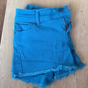 Blue shorts with frayed edges